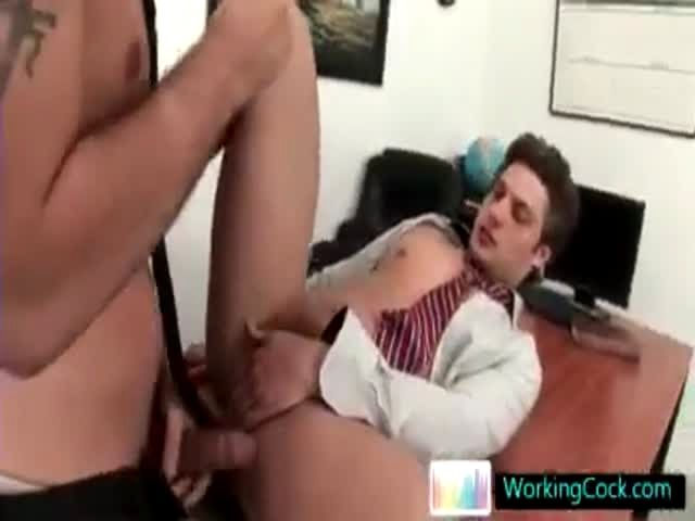 Two awesome hunks having gay sex in office