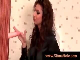 Glamurous slut playing with gloryhole cock