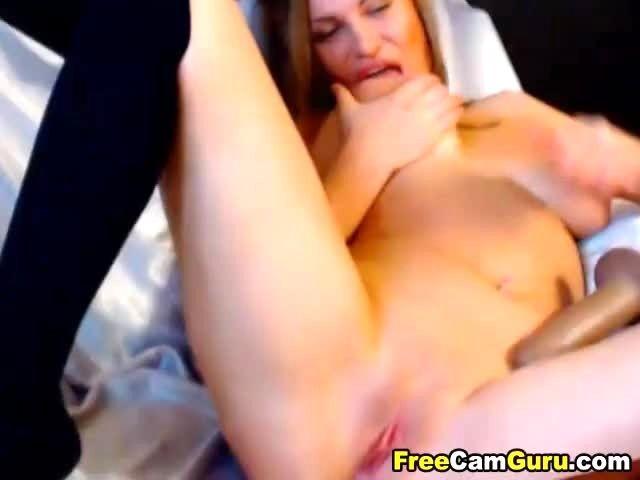 image Babe strokes her dildo deep till she climax