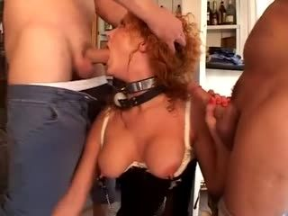 Slutty redhead does two cocks