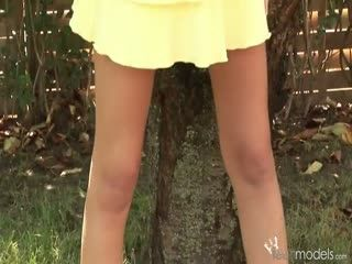 Brunette teen toying herself outdoors