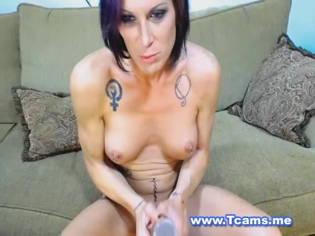 Busty tranny strokes her big cock on cam