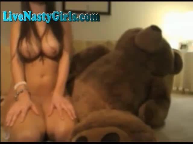 Jumbo teddy bear fucks a girl
