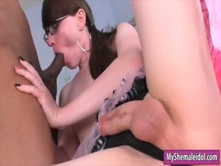 Sexy tgirl with glasses gets ass pounded