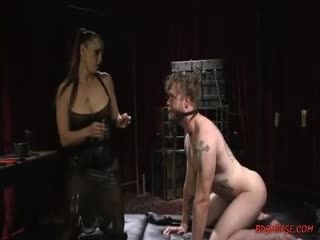 Femdom Scene With A Busty Mistress Pegging A Guy