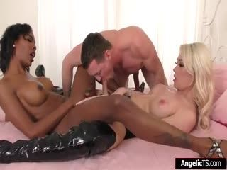 Two Busty Shemales Are Dominating A Guy